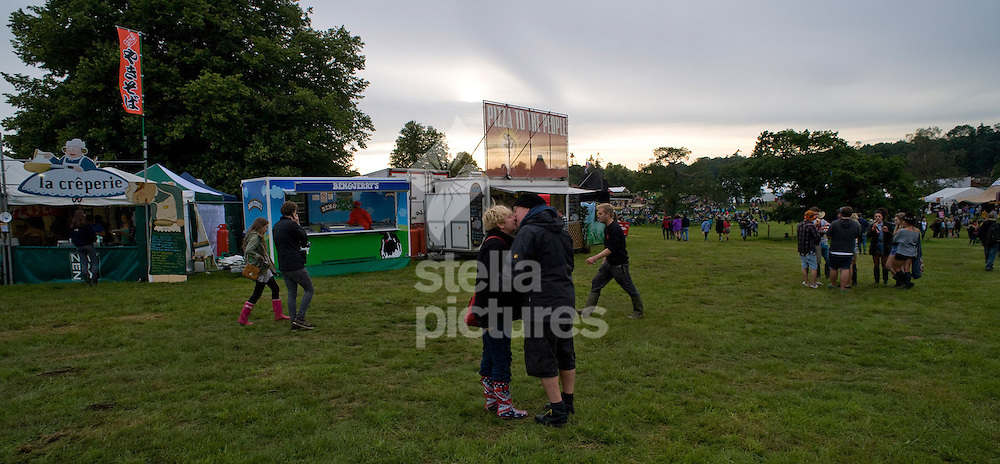 Picture by Daniel Hambury. .14/7/11..A couple kiss at Latitude, a music and arts festival set on the Henham Estate in Suffolk..The event runs from July 14th to 17th 2011.
