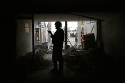 U.S. soldiers from the 1st AD walk the site of the explosion at the Canal Hotel in Baghdad, Iraq on Aug. 21, 2003. The previous day a cement truck packed with explosives detonated outside the offices of the UN headquarters in Baghdad, Iraq, killing 20 people and devastating the facility in an unprecedented suicide attack against the world body. At least 100 people were wounded.