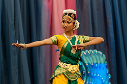 © Licensed to London News Pictures. 05/09/2015. Watford, UK. Local schoolgirl, Haripriya, aged 16, performs a classical dance on stage during the biggest Janmashtami festival outside of India at the Bhaktivedanta Manor Hare Krishna Temple in Watford, Hertfordshire.  The event celebrates the birth of Lord Krishna and the festival  includes music, dance, food, dramas and more. Photo credit : Stephen Chung/LNP