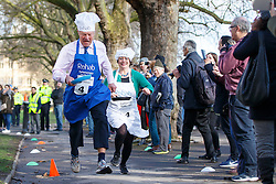 © Licensed to London News Pictures. 28/02/2017. London, UK. LORD ST JOHN OF BLESTO and CATHERINE MCKINNELL race at the annual Rehab Parliamentary Pancake Race outside the Parliament on Shrove Tuesday, 28 February 2017. Photo credit: Tolga Akmen/LNP