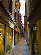 Narrow Venice street and expensive shops with pedestrians