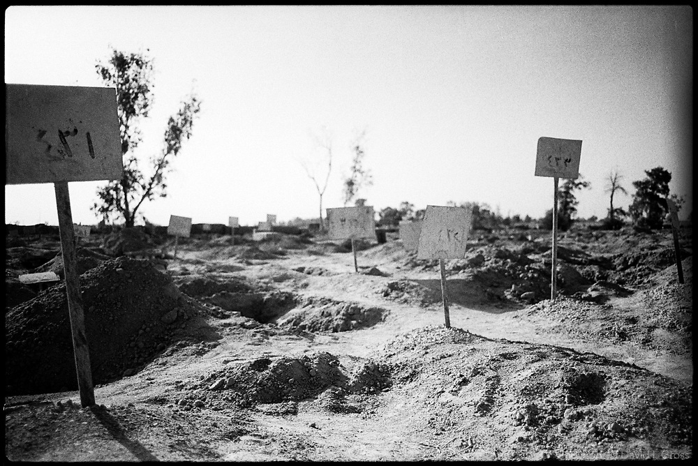 Inside the graveyard at Abu Ghraib, Iraq, next to the prison, a walled-off plot held the remains of prisoners who were executed during the fighting. Most of the graves are exhumed.