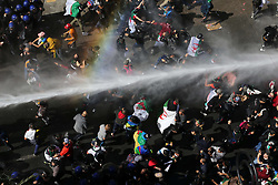 March 29, 2019 - Algiers, Algeria - Algerian riot police clash with demonstrators taking part in a mass protest against Algerian President Bouteflika after his decision to postpone the presidential elections of April 2019 and to stay in power after his current term ends for an unspecified transitional period.  (Credit Image: © Billal Bensalem/NurPhoto via ZUMA Press)