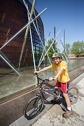 United States, Washington, Redmond, boy on bicycle at Redmond City Hall
