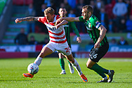 James Coppinger of Doncaster Rovers (26) and Liam Kelly of Coventry City (6) in action during the EFL Sky Bet League 1 match between Doncaster Rovers and Coventry City at the Keepmoat Stadium, Doncaster, England on 4 May 2019.