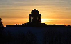 © Licensed to London News Pictures. 16/02/2016. Castle Howard, UK. The sun rises behind the Mausoleum at Castle Howard, North Yorkshire. Photo credit : Anna Gowthorpe/LNP
