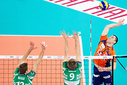 Andrea Rossi and Nikola Grbic of Cuneo vs Andrej Flajs of ACH during volleyball match between ACH Volley Ljubljana and Bre Banca Lannutti Cuneo (ITA) in Playoff 12 game of CEV Champions League 2012/13 on January 15, 2013 in Arena Stozice, Ljubljana, Slovenia. (Photo By Vid Ponikvar / Sportida.com)