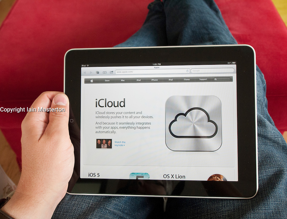 Detail of Apple website showing iCloud cloud computing service on iPad digital tablet