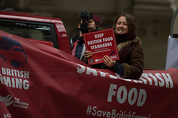 Licensed to London News Pictures. 12/10/2020. London, UK. Farmers are seen driving tractors through Smith Square for the offices of Department for Environment, Food and Rural Affairs, central London to urge the government to protect food standards bill in post-Brexit trade bill. Photo credit: Marcin Nowak/LNP