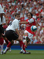 Photo: Tony Oudot. <br /> Arsenal v Fulham. Barclays Premiership. 12/08/2007. <br /> Tomas Rosicky of Arsenal fires in a shot past Chris Baird of Fulham