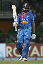 March 18, 2018 - Colombo, Sri Lanka - Indian cricket captain Rohit Sharma celebrates his 50 runs during the final Twenty-20 cricket match of NIDAHAS Trophy  between Bangladesh and India at R Premadasa cricket ground, Colombo, Sri Lanka on Sunday 18 March 2018. (Credit Image: © Tharaka Basnayaka/NurPhoto via ZUMA Press)