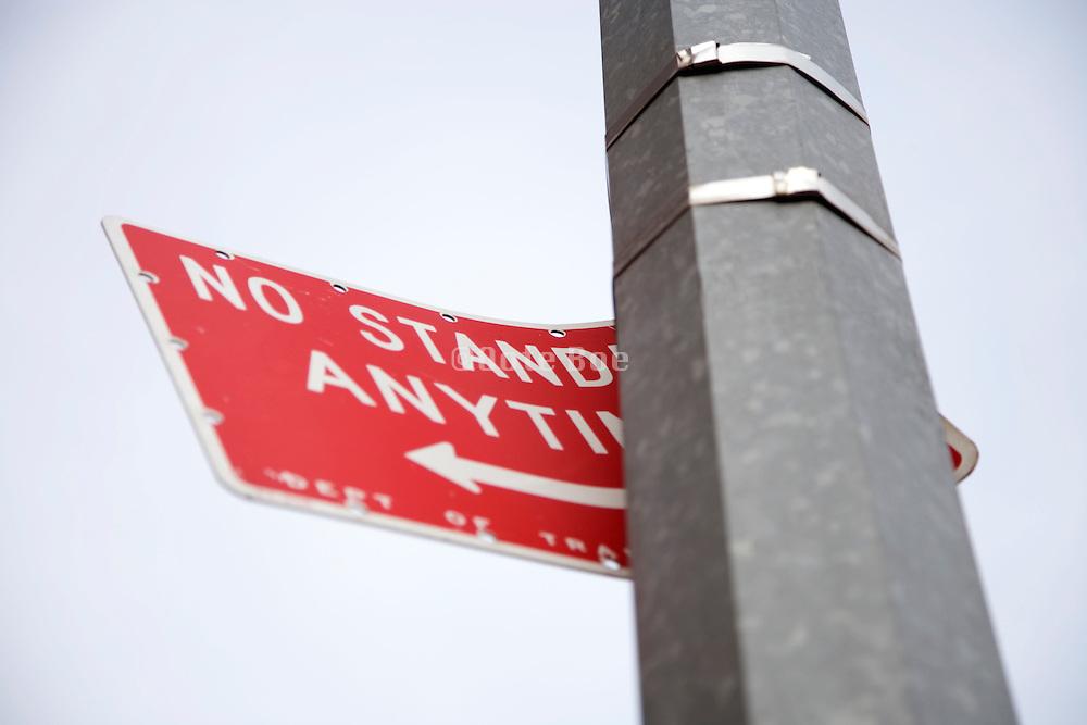 a bent No standing traffic sign