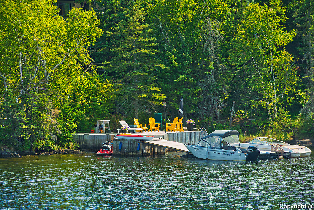 Chairs on dock on Lake of the Woods<br />Kenora<br />Ontario<br />Canada