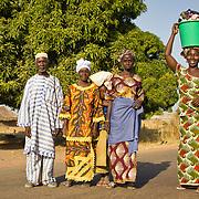A family, dressed up in traditional clothing for the weekly highlight of Koumbadiouma's social calendar, the Sunday market. Kolda, Senegal.
