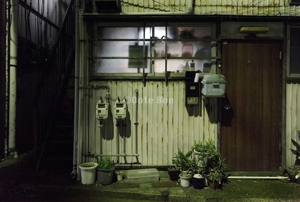 from inside lighted up kitchen window of a residential house Japan