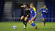 Lincoln City Midfielder James Jones (8) and Jaakko Oksanen of AFC Wimbledon  during the EFL Sky Bet League 1 match between AFC Wimbledon and Lincoln City at Plough Lane, London, United Kingdom on 2 January 2021.