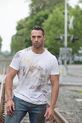 rugged man in a dirty tee shirt