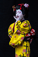 34. Kabuki 歌舞伎  is a traditional Japanese form of theater rich in showmanship, involving elaborately designed costumes, dramatic wigs, meticulous makeup and exaggerated voices and movements all performed exclusively by male actors. Highly stylized gestures convey meaning to the audience.  The plots are based on historical events, moral conflicts, love stories, tales of tragedy or conspiracy.  The use of dynamic stage sets, incorporating revolving platforms and trap doors permit quick scene changes and the sudden appearance and disappearance of characters.  These elements combine to produce a unique and stunning performance.  Kabuki is recognized as one of Japan's three major classical performing arts along with noh and bunraku.