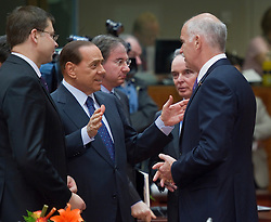Silvio Berlusconi, Italy's prime minister, center, speaks with George Papandreou, Greece's prime minister, right, and Valdis Dombrovskis, Latvia's prime minister, left, during the European Summit meeting at EU Council headquarters in Brussels, Belgium, on Thursday, June 17, 2010. (Photo © Jock Fistick)