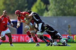 Peter Browne (London Welsh) is tackled - Photo mandatory by-line: Patrick Khachfe/JMP - Mobile: 07966 386802 06/09/2014 - SPORT - RUGBY UNION - Oxford - Kassam Stadium - London Welsh v Exeter Chiefs - Aviva Premiership