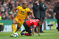 Football - 2018 / 2019 Premier League - Southampton vs. Wolverhampton Wanderers<br /> <br /> Adama Traore of Wolverhampton Wanderers leaves Southampton's Ryan Bertrand on the floor to set up a Wolves attack at St Mary's Stadium Southampton<br /> <br /> COLORSPORT/SHAUN BOGGUST