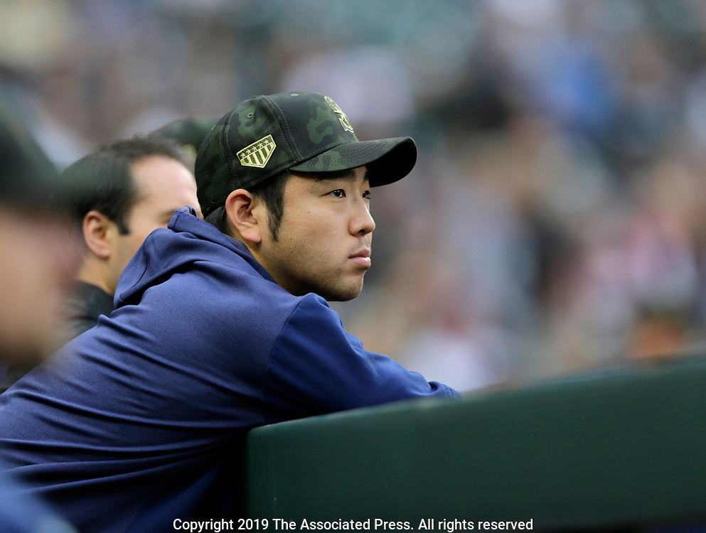 Seattle Mariners pitcher Yusei Kikuchi looks out to the field from the dugout before a baseball game against the Minnesota Twins, Saturday, May 18, 2019, in Seattle. (AP Photo/John Froschauer)