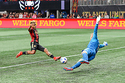 March 11, 2018 - Atlanta, GA, U.S. - ATLANTA, GA Ð MARCH 11:  Atlanta United's Josef Martinez (7) scores a goal against DC United goal keeper David Ousted (1) during the match between DC United and Atlanta United on March 11, 2018 at Mercedes-Benz Stadium in Atlanta, GA.  Atlanta United FC defeated DC United by a score of 3 - 1.  (Photo by Rich von Biberstein/Icon Sportswire) (Credit Image: © Rich Von Biberstein/Icon SMI via ZUMA Press)