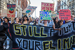 London, UK. 20 September, 2019. Students and climate campaigners march behind a banner during the second Global Climate Strike in protest against a lack of urgent action by the UK Government to combat the global climate crisis. The Global Climate Strike grew out of the Fridays for Future movement and is organised in the UK by the UK Student Climate Network.