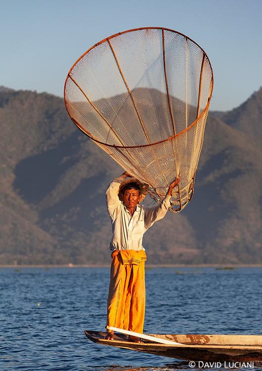 Intha fisherman posing on Inle Lake.