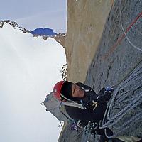 Rick Ridgeway jumars up to a belay station on the vertical east face of Rakekniven Spire, Queen Maud, Antarctica.