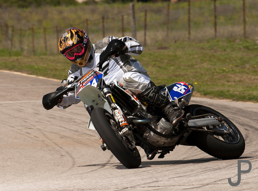 AMA Pro rider Monte Frank on KTM supermoto bike at racetrack