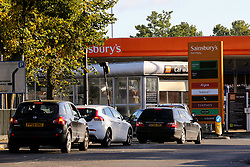 © Licensed to London News Pictures. 06/10/2021. London, UK. A smaller number of motorists queue for the thirteen day at a Sainsbury's petrol station in north London, as the fuel shortages begin to ease, with members of the armed forces helping to tackle the crisis by driving fuel lorries. Photo credit: Dinendra Haria/LNP