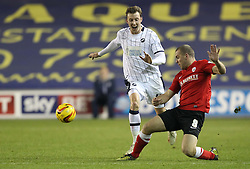 Barnsley's Stephen Dawson tackles Millwall's Martyn Woolford - Photo mandatory by-line: Robin White/JMP - Tel: Mobile: 07966 386802 23/11/2013 - SPORT - Football - Millwall - The Den - Millwall v Barnsley - Sky Bet Championship