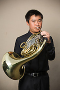 Eric Zien, MHS junior, poses for a portrait with his French Horn before performing in the Milpitas Unified School District's 11th Annual Music Festival at Milpitas High School in Milpitas, California, on April 10, 2014. (Stan Olszewski/SOSKIphoto)