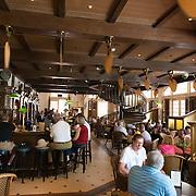 Raffles Hotel Long Bar interior with visitors, Singapore