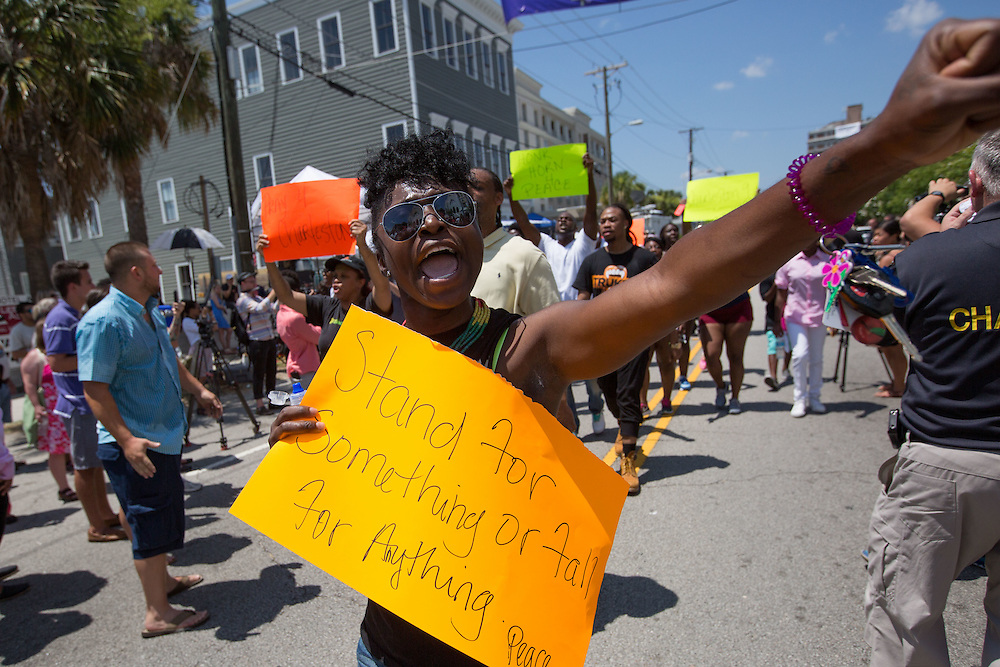 A woman marches in front of Emanuel African Methodist Episcopal Church following services on June 21, 2015 in Charleston, South Carolina. On June 17, 2015, nine people were shot and killed inside the church during Bible study. A suspect, Dylann Roof, 21, was arrested in connection with the shootings. Photo by Kevin Liles/UPI