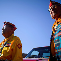081415       Cable Hoover<br /> <br /> Navajo Codetalkers William Toledo, left, David Patterson and Joe Vandever stand together at the start of the Codetalker Day parade Friday in Window Rock.