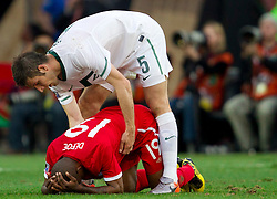 Bostjan Cesar of Slovenia apologizes to Jermain Defoe of England during the 2010 FIFA World Cup South Africa Group C Third Round match between Slovenia and England on June 23, 2010 at Nelson Mandela Bay Stadium, Port Elizabeth, South Africa. England defeated Slovenia 1-0 and qualified for the next round, Slovenia not. (Photo by Vid Ponikvar / Sportida)