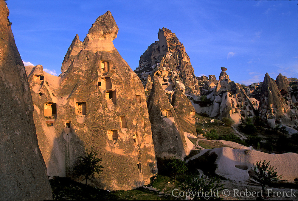 TURKEY, ANATOLIA, CAPPADOCIA Uchisar village and castle cut into rock