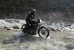 Round the World Doug Wothke navigates a water crossing on Day-7 of our Himalayan Heroes adventure riding from Tatopani to Pokhara, Nepal. Monday, November 12, 2018. Photography ©2018 Michael Lichter.