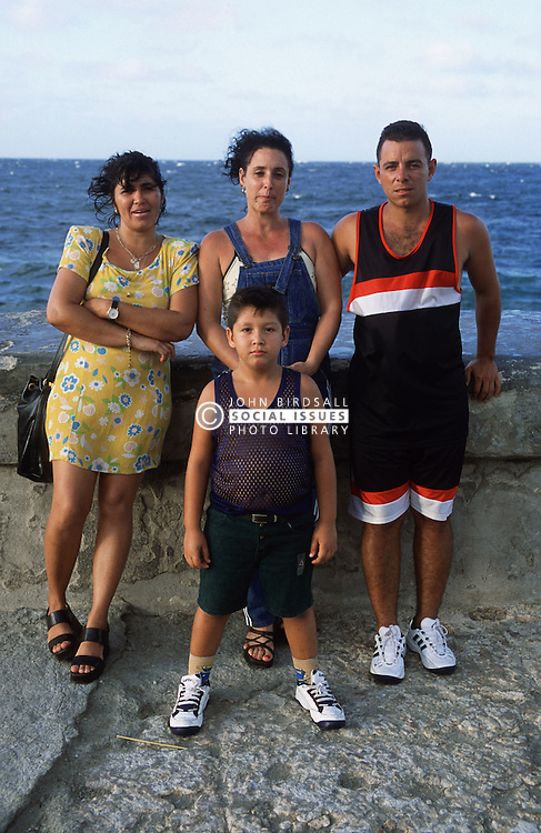 Family group standing together on seafront in Havana  the Malecon,