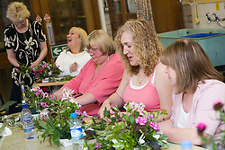 Group of Acorn Day Centre service users taking part in a flower arranging class,