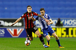 AFC Bournemouth's Connor Mahoney (left) and Wigan Athletic's Callum Elder battle for the ball during the Emirates FA Cup, Third Round Replay at the DW Stadium, Wigan.