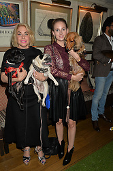 Left to right, BRIX SMITH START and her dogs Gladys and Pixie and ROSIE FORTESCUE and her dog Noodles at A Date With Your Dog At George in aid of the Dogs Trust held at George, 87-88 Mount Street, London on 9th September 2014.
