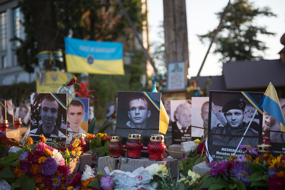 A memorial with flowers, Ukrainian flags, and photos of those killed during the 2014 Euromaidan protest is located near Maidan Nezalezhnosti, the central square in Kiev, Ukraine.