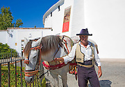 Horseman and his horse in traditional riding clothes near the bullring in Ronda, Spain