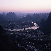 Early morning light over landscape of Yangshuo and myriad karst towers, Yangshuo, Guilin, China