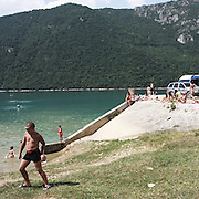 """A child play on a lake. There are several arguments about the derivation of the name  """"Montenegro"""", one of these relates to dark and deep forests  that once covered the Dinaric Alps, as it was possible to see them from the sea. <br /> Mostly mountainous with 672180 habitants on an area of 13812 Km², with a population density of  48 habitants/Km². <br /> It borders with Bosnia, Serbia, Croatia, Kosovo and Albania but  Montenegro has always been alien to the bloody political events that characterized Eastern Europe in recent decades. <br /> From 3 June 2006, breaking away from Serbia, Montenegro became an independent state. <br /> In the balance between economy devoted to sheep farming and a shy tourist, mostly coming from Bosnia and Herzegovina, Montenegro looks to Europe with a largely unspoiled natural beauty. <br /> Several cities in Montenegro, as well as the park Durmitor, considered World Heritage by UNESCO but not yet officially because Montenegro has yet to ratify the World Heritage Convention of UNESCO."""
