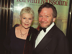 """Dame Judi Dench with her husband Michael Williams at the Royal Premiere of her film """"Tea With Mussolini,"""" at the Empire Leicester Square, London. R/I: 25/6/99.   *12/01/01 Mr Williams has died after a long battle with cancer, aged 65, his agent said."""