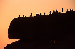 MALTA GOZO DWEJRA JUL00 - A group of toursist on the rocks above the window of Dwejra during sunset.. . jre/Photo by Jiri Rezac. . © Jiri Rezac 2000. . Tel:   +44 (0) 7050 110 417. Email: info@jirirezac.com. Web:   www.jirirezac.com